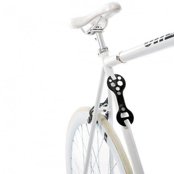 Cykel-konnyckel och flasköppnare Två-i-ett set