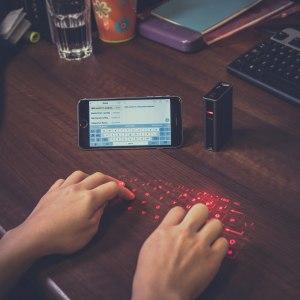 För Smartphone & Co. Laser Keyboard & Power Bank