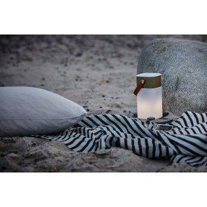 Lysande högtalare, powerbank och lampa i ett