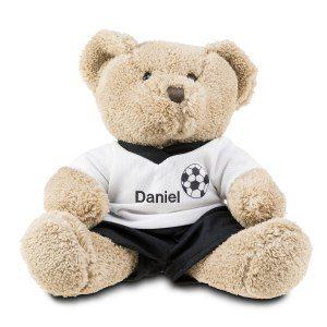 Teddybjörn som bär fotbollströja med namn